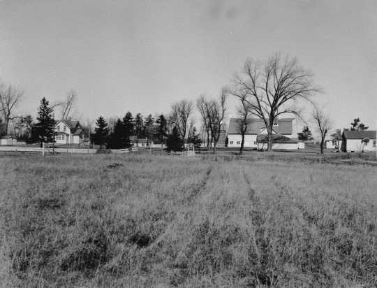 Black and white photograph of the Meeker County farm of the Charles Ness family, 1947.