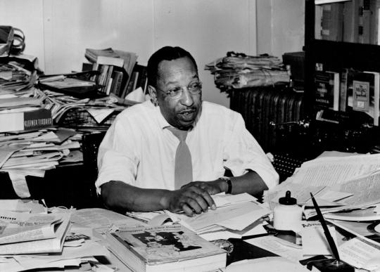 Cecil Newman at his desk