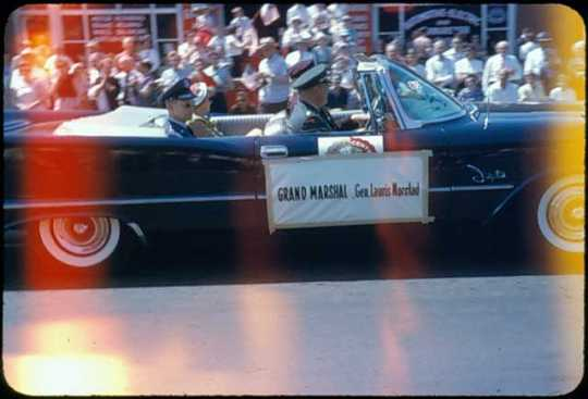 Grand Marshal General Lauris Norstad in a convertible at the Centennial Parade, St. Paul