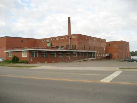Color image of north and east façades, of Faribault Woolen Mill Company, 2011.