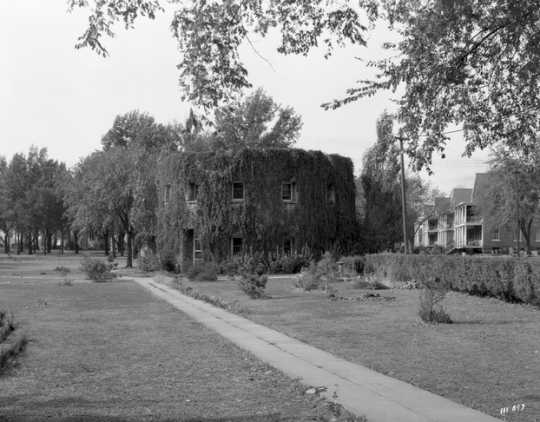 Black and white photograph of the Round tower covered in vegetation,1935. Photographed by Norton and Peel.
