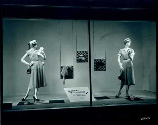 Black and white photograph of a window display of dresses, Donaldson's, 1950. Photograph by Norton & Peel.