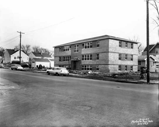 View of an apartment building at 2419 Plymouth Avenue in Near North Minneapolis. ca. 1957. Photo by Norton & Peel.