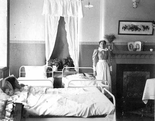 Nurse with patient in Fergus Falls State Hospital.