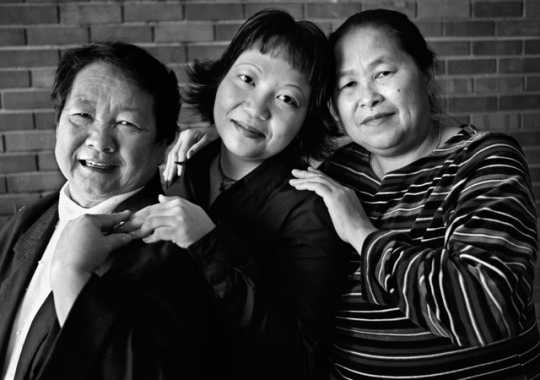 Black and white photograph of three generations of Hmong women (Mao Thao Yang, Mai Vang Thao, and Bo Thao), 1999.