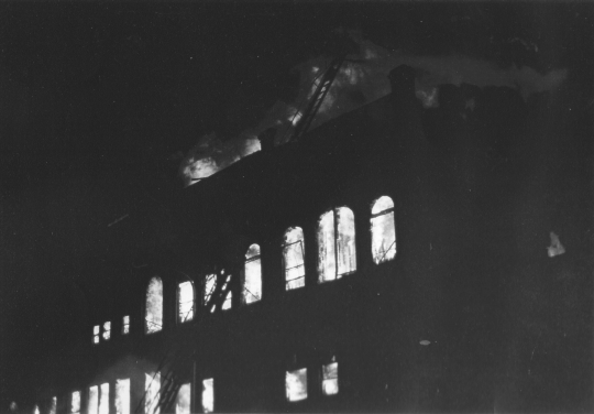 Flames from the 1987 Opera House Block fire light up the night and smoke is seen up to ten miles away.