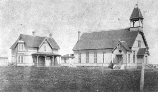 Black and white photograph of the exterior of the Immaculate Heart of Mary Catholic Church in Currie, ca. 1883.