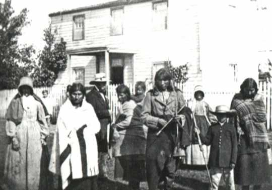 Black and white photograph of Dakota Indians at Williamson home (Pajutazee Mission) near Yellow Medicine, 1862.