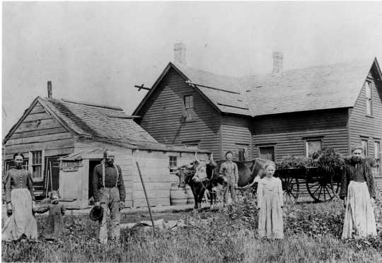 Polish immigrants in front of their farmhouse