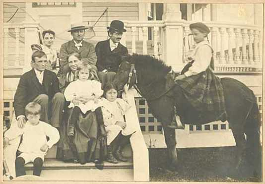 Photograph of the Ueland family and a pony near their Minneapolis home, ca. 1895.
