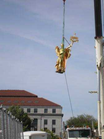 "Color image of the figure of ""Prosperity"" being removed for restoration, September 23, 2014. Photographed by Linda A. Cameron."