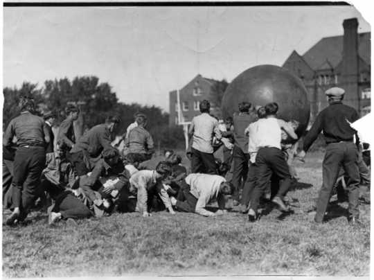 """Photograph of students playing """"pushball,"""" Macalester, 1924"""