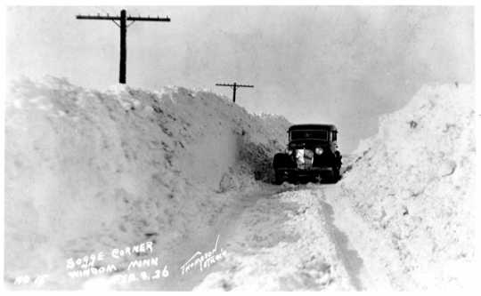 Car driving through a snowbank