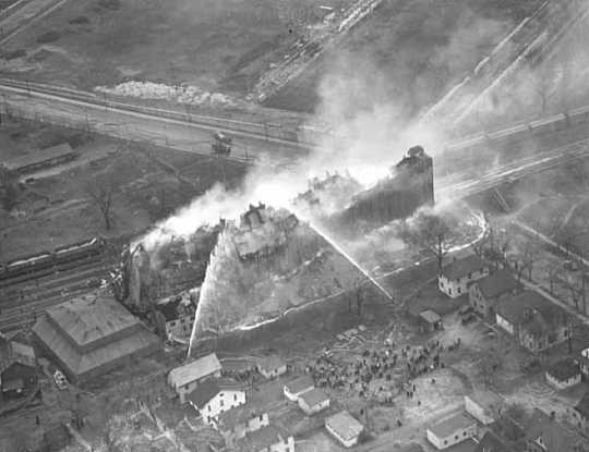 Black and white aerial image of a fire in the University District in 1938.