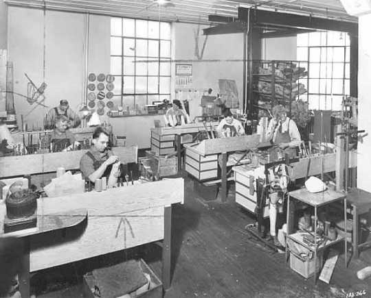 Black and white photograph of a work room, Minneapolis Artificial Limb Company, 1940.