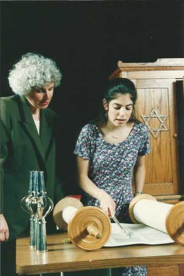 Color photograph of Rabbi Stacy Offner with a congregant of Shir Tikvah Synagogue.