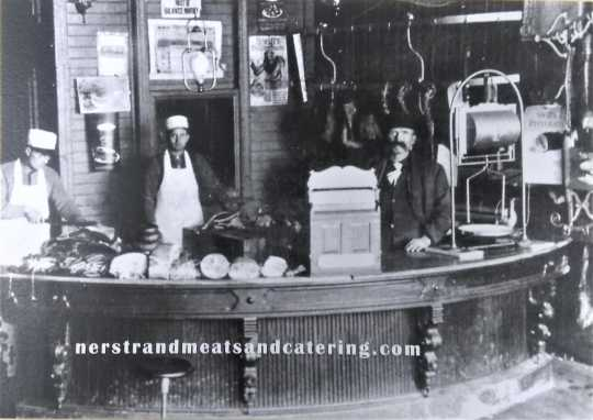 Remodeled Nerstrand Meat Market, ca. 1900. Pictured are (left to right): Lewis Roth, William Roth, and an unidentified man.