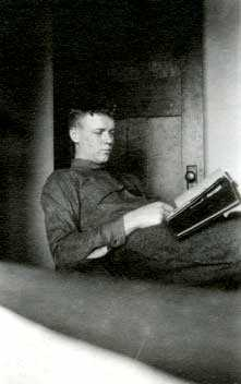 Black and white photograph of Charles Augustus Lindbergh and his photo album, Madison, Wisconsin, March, 1922.