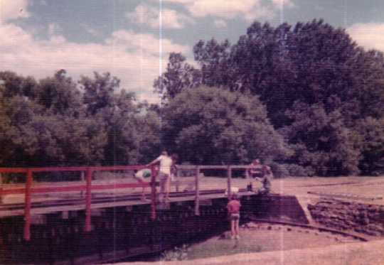 Color image of Poco-a-Poco 4-H Club members restoring the Chicago, St. Paul, Minneapolis & Omaha turntable, 1972.