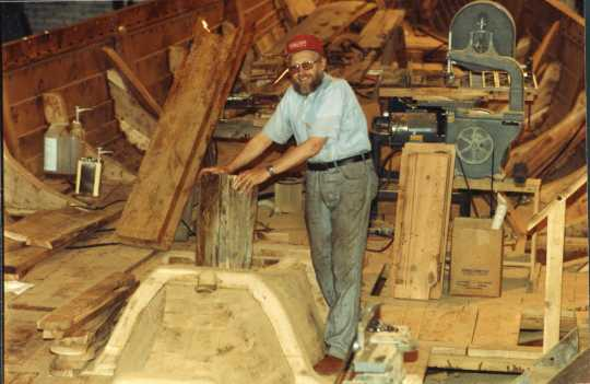 Color image of Robert Asp working on board the Hjemkomst. Photograph by Rose Asp, ca. 1980. From the Rose Asp Collection, Historical and Cultural Society of Clay County.