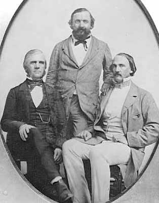 Black and white photograph of Rolette (standing) with business associates Henry Hastings Sibley (right), and possibly Franklin Steele (left), c.1857.