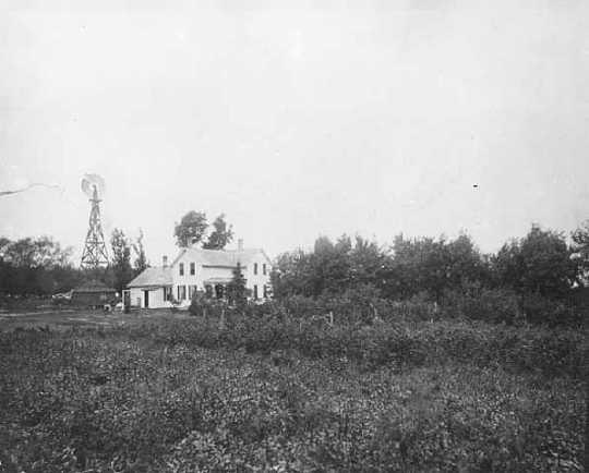 Black and white photograph of a Minnesota farm house, ca. 1890.