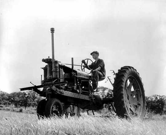 Black and white photograph of a Farmall tractor on the farm of Mike O'Boyle, St. Paul Park, 1938.