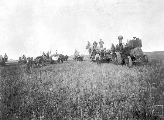 Black and white photograph of a threshing scene at the Lockhart farm, Norman County, Minnesota, 1885. Photograph by: Mrs. C. P. Cahoon.