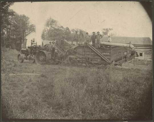 Photograph of farmers and threshing machine, ca. 1900