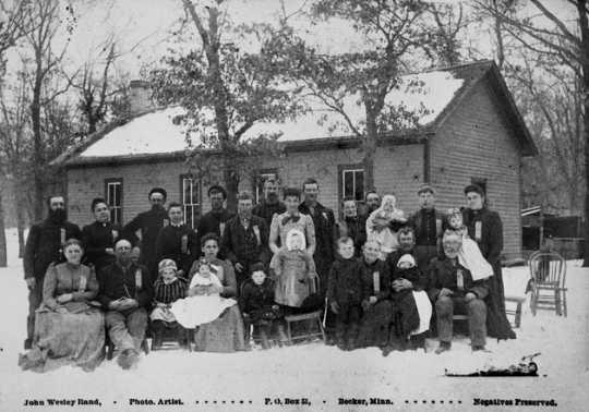 Black and white photograph of Crescent Grange Hall and members, Linwood Township, Anoka County, 1880.