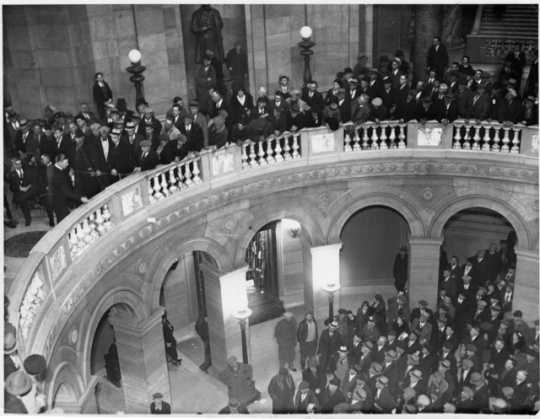 Black and white photograph of thousands of farmers gathering at the Minnesota State Capitol to hear Governor Floyd B. Olson talk on farm relief, ca. 1935.