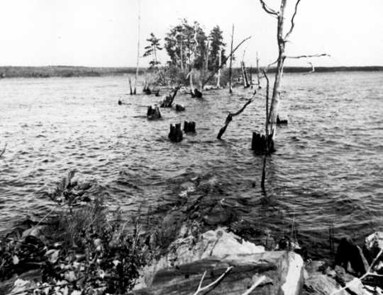 In the 1920s and 1930s, Ernest Oberholtzer documented flood damage associated with existing Rainy Lake dams in an attempt to prevent Edward Backus from constructing more dams, causing additional damage. This image documents damage related to a storage dam on Namakan Lake.