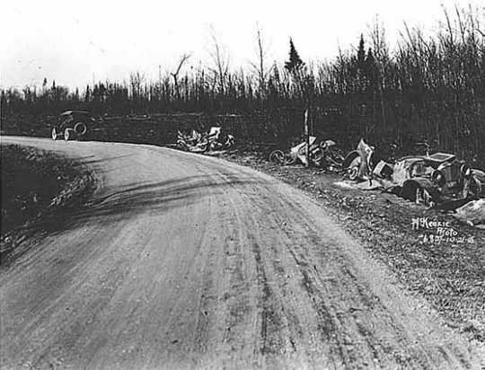 Black and white photograph of wrecked cars along Pike Lake Road near Duluth, 1918.