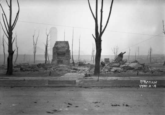 Black and white photograph of building ruins, Cloquet, 1918.