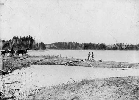 Black and white photograph of Jacob Brower at the Lake Itasca basin at DeSoto Lake, 1889.
