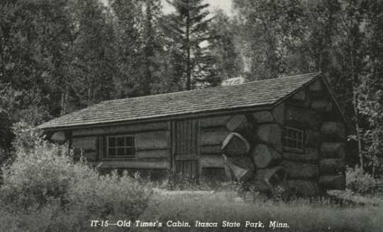 Black and white photograph of a cbin in Itasca State Park built by the Civilian Conservation Corps, ca. 1940.