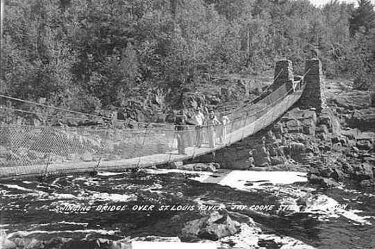Black and white photograph of the 1939 swinging bridge over St. Louis River, Jay Cooke State Park, ca. 1950.