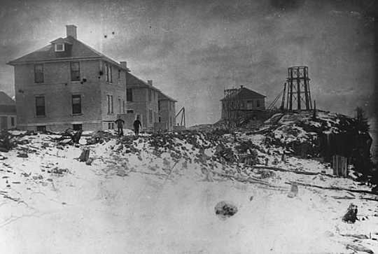 Black and white photograph of Split Rock Lighthouse being built c.1909.