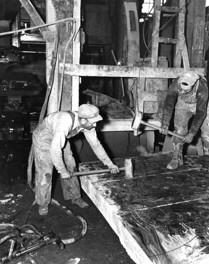 Black and white photograph of Splitting Granite, c.1938.