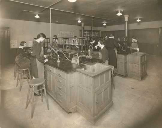 Black and white photograph of students at St. Joseph's Academy performing experiments in the school's chemistry lab, c.1930s.
