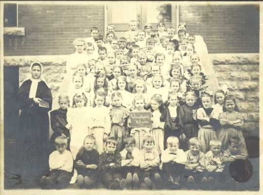 Students of St. Stanislaus School with their teacher