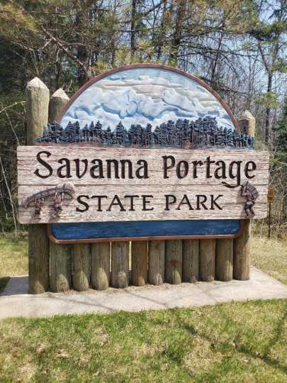 Entrance sign at Savanna Portage State Park acknowledging the area's Indigenous and fur-trading history, 2018. Photograph by Jon Lurie; used with the permission of Jon Lurie.