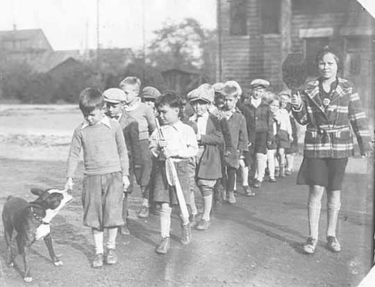 Group of children being escorted by School Police.