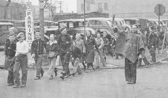 The children of Franklin School being escorted across the street by school police, St. Paul.