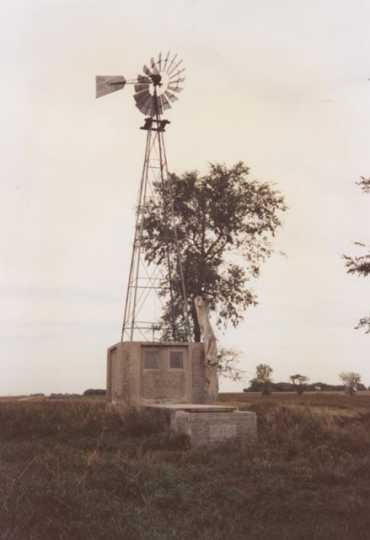 Color image of a windmill near Schott Barn, c.1985.
