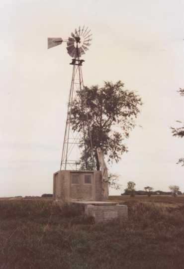 Color image of a windmill near Schott Barn, c.1985.