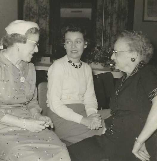 Black and white photograph of a BPW club breakfast, September 22, 1957. Picture (left to right) are Frances Engebretson, Peggy Running, and Sue Monroe.