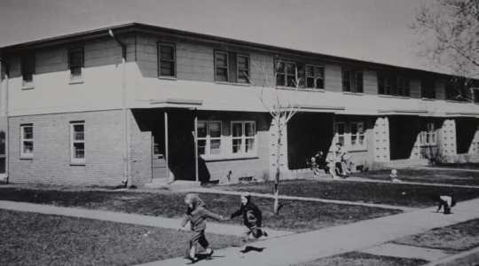 Children playing in front of Glendale Townhomes, ca. 1960s. Photographer unknown. Film still from Interstate 94: A History and Its Impact (Twin Cities PBS, April 1, 2017), 17:45.
