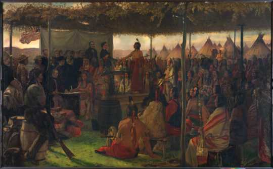 Color image of a painting of the Treaty of Traverse des Sioux, c.1905. Oil painting by Francis Davis Millet.