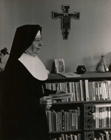 Black and white photograph of Alice Gustava Smith (Sister Maris Stella) in her office at the College of St. Catherine, c.1970.